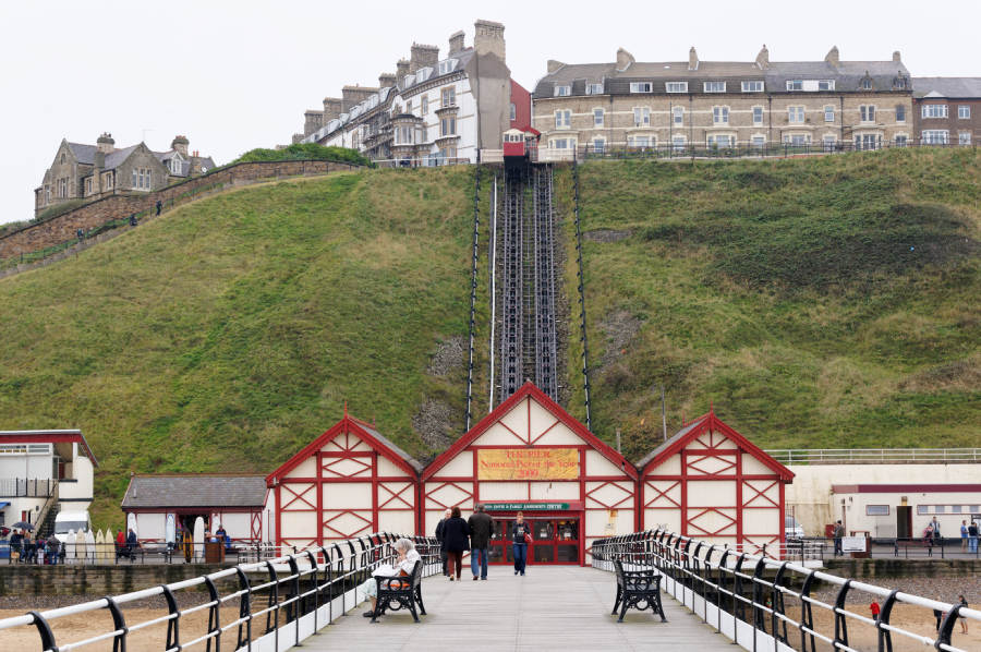 My mother reads on a bench, Saltburn pier.