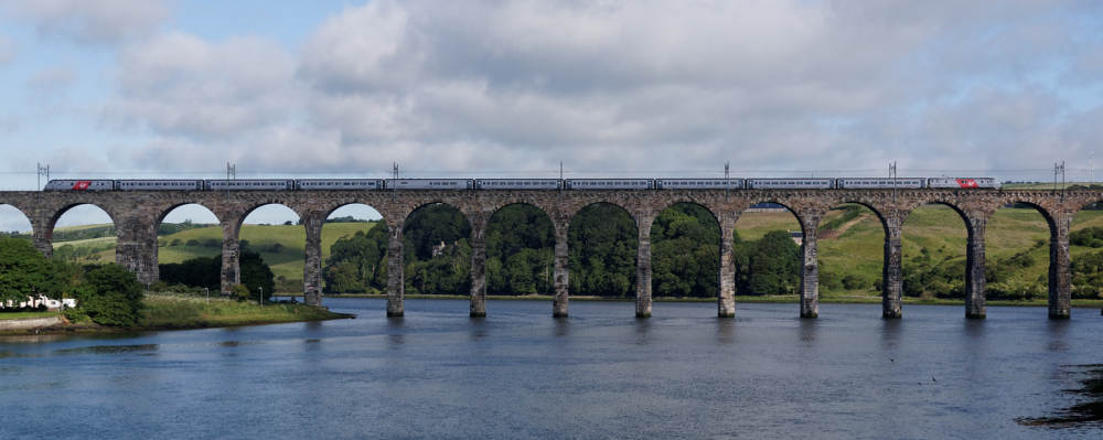Virgin East Coast train crosses the Royal Border Bridge, Berwick on Tweed