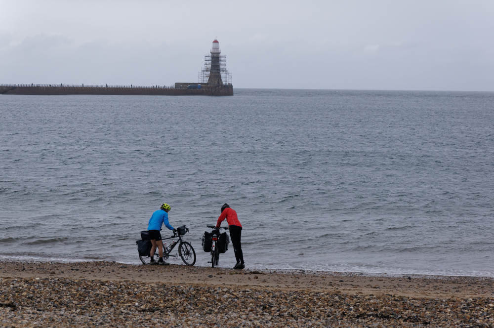 The ceremonial dipping of the wheels before starting the Walney to Wear (in reverse) section in the shadow of Roker lighthouse.