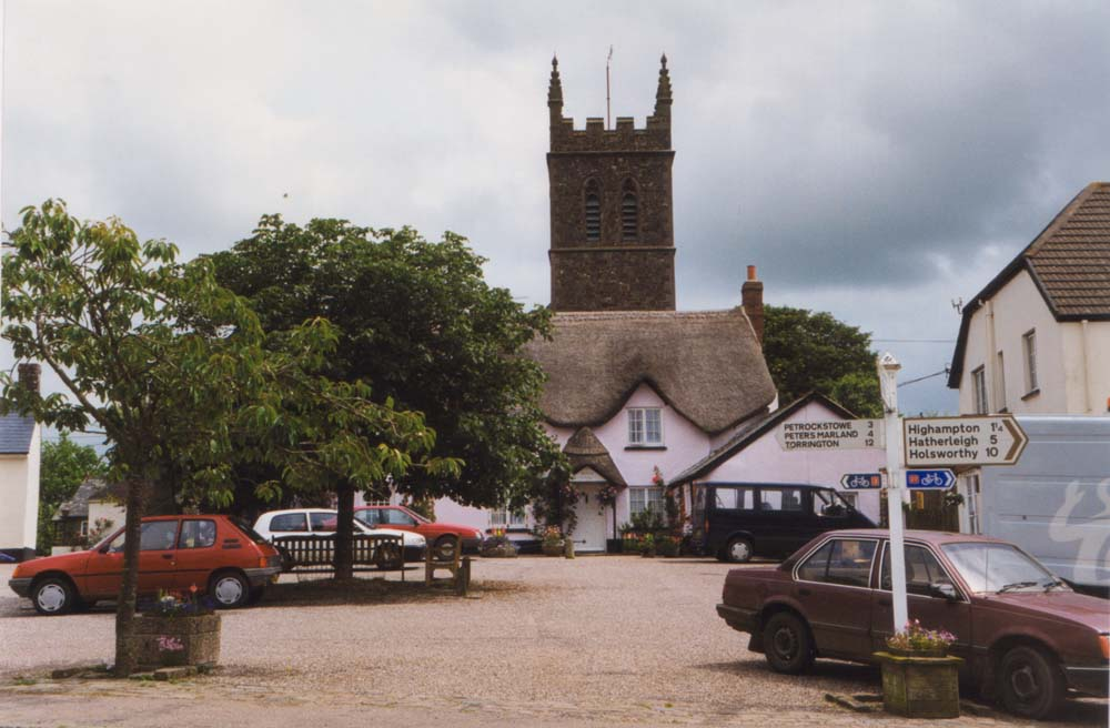 Sheepwash village square, pity about the parked cars.