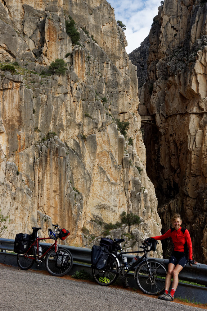The Camino del Rey is above Christine, halfway up the rock face.