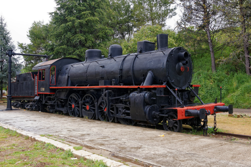 Static preserved locomotive on the via verde at Cabra