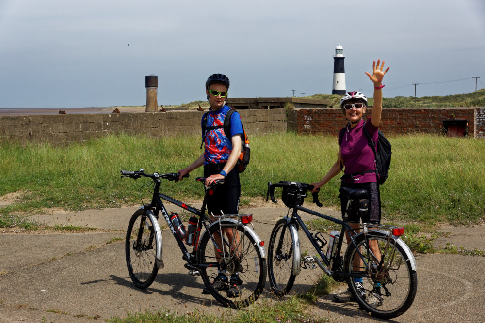 Rowan and Christine at Spurn Head with waerime remains, Low Light and the lighthouse.
